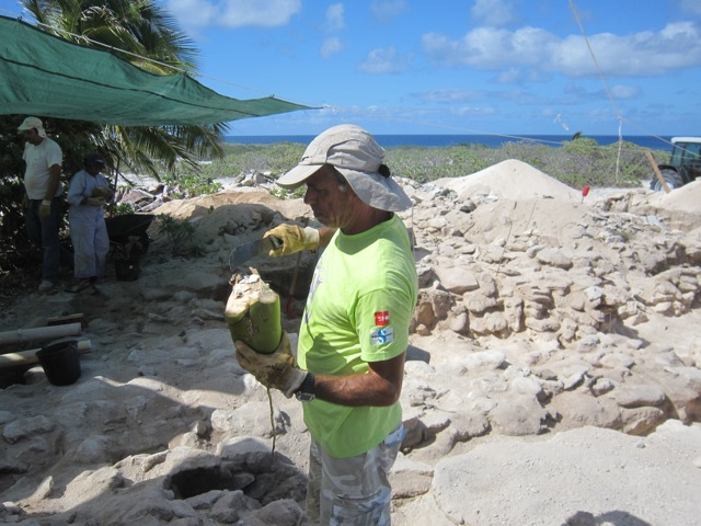 Philippe brings some coconuts to the searchers